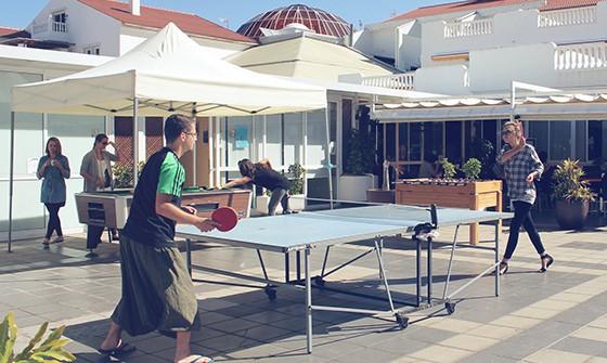 People playing ping pong